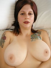 Young sensual Maggy showing off her heavy natural 34 DDs